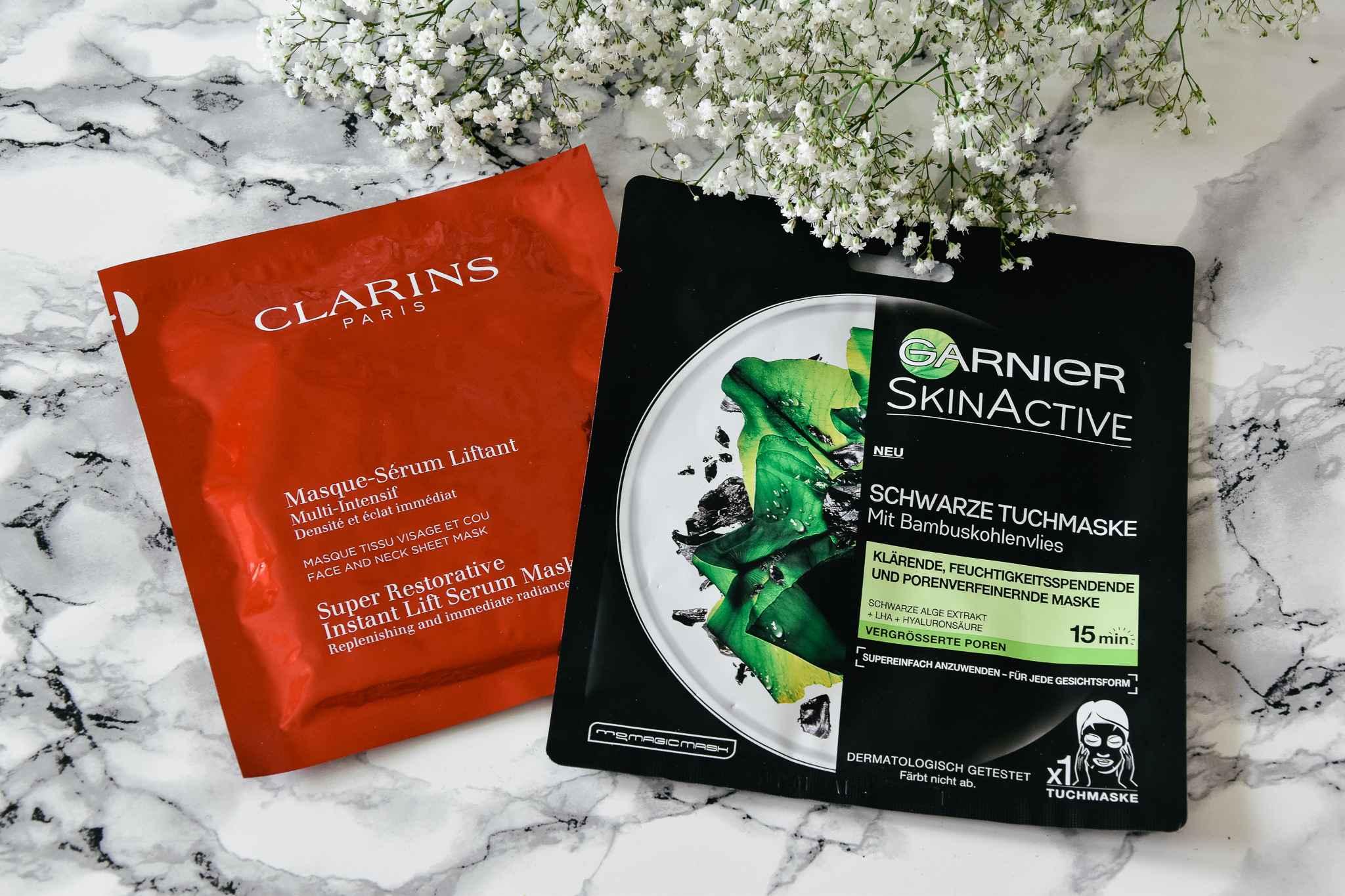 Garnier schwarze Tuchmaske Clarins Instant Lift serum Maske